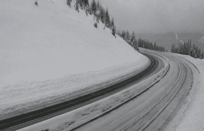 Snow slide blocking I-90 traffic on Lookout Pass near